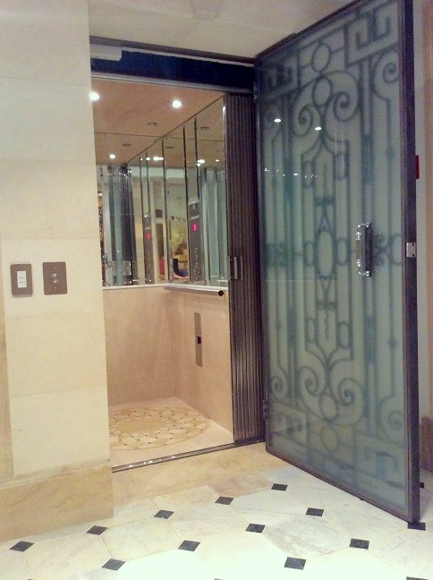 Sleek and modern residential elevators installed by for Modern home elevators